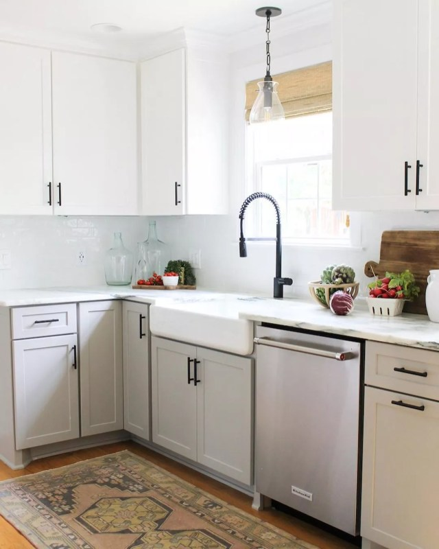 Updated Kitchen with Refaced White Cabinets with Black Pulls. Photo by Instagram user @melissawhitted.interiors