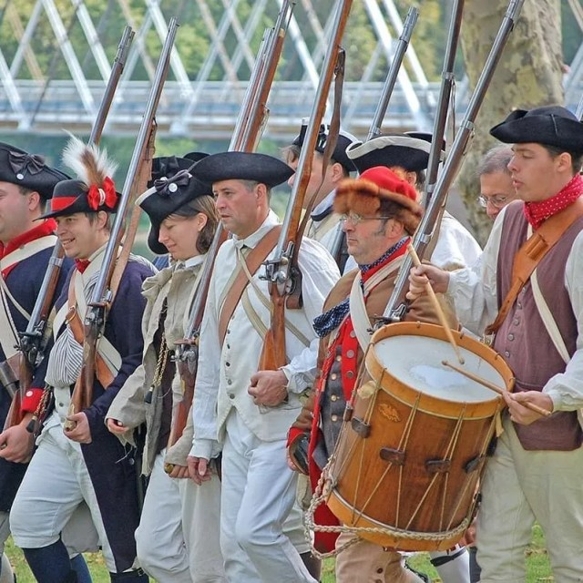 Reenactment of a colonial march in 1775, including costume accuracy, drumbeats, and muskets. Photo by Instagram user @ washingtoncrossingpark