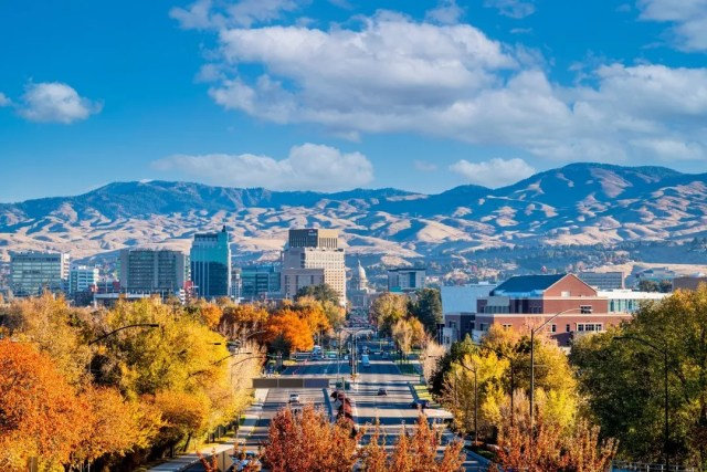 View of Boise, with mountains and Downtown in the background and trees changing color. Photo by Instagram user @visitboise.