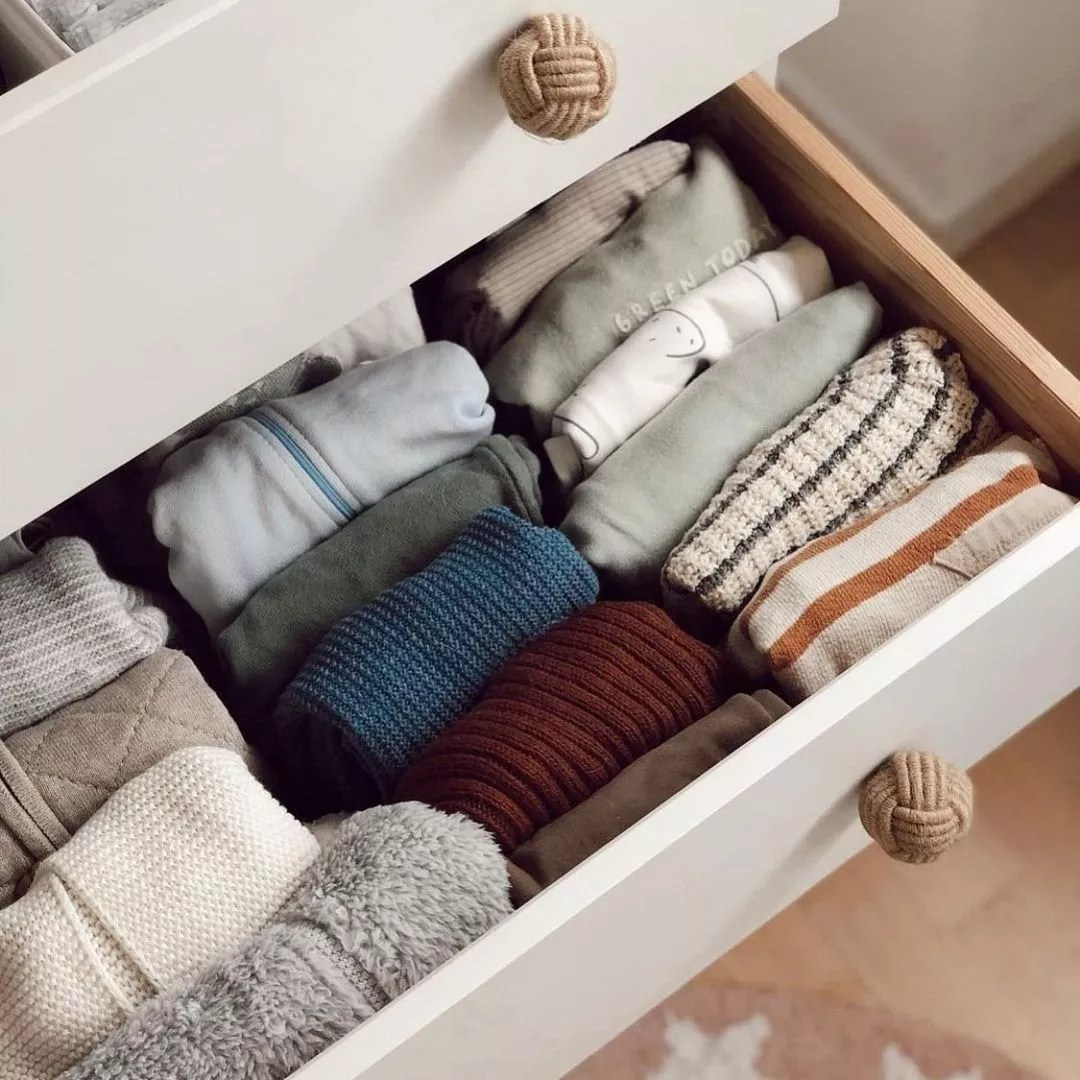 Dresser drawer open to show clothes folded in a file pattern. Photo by Instagram user @thedesignimpact.