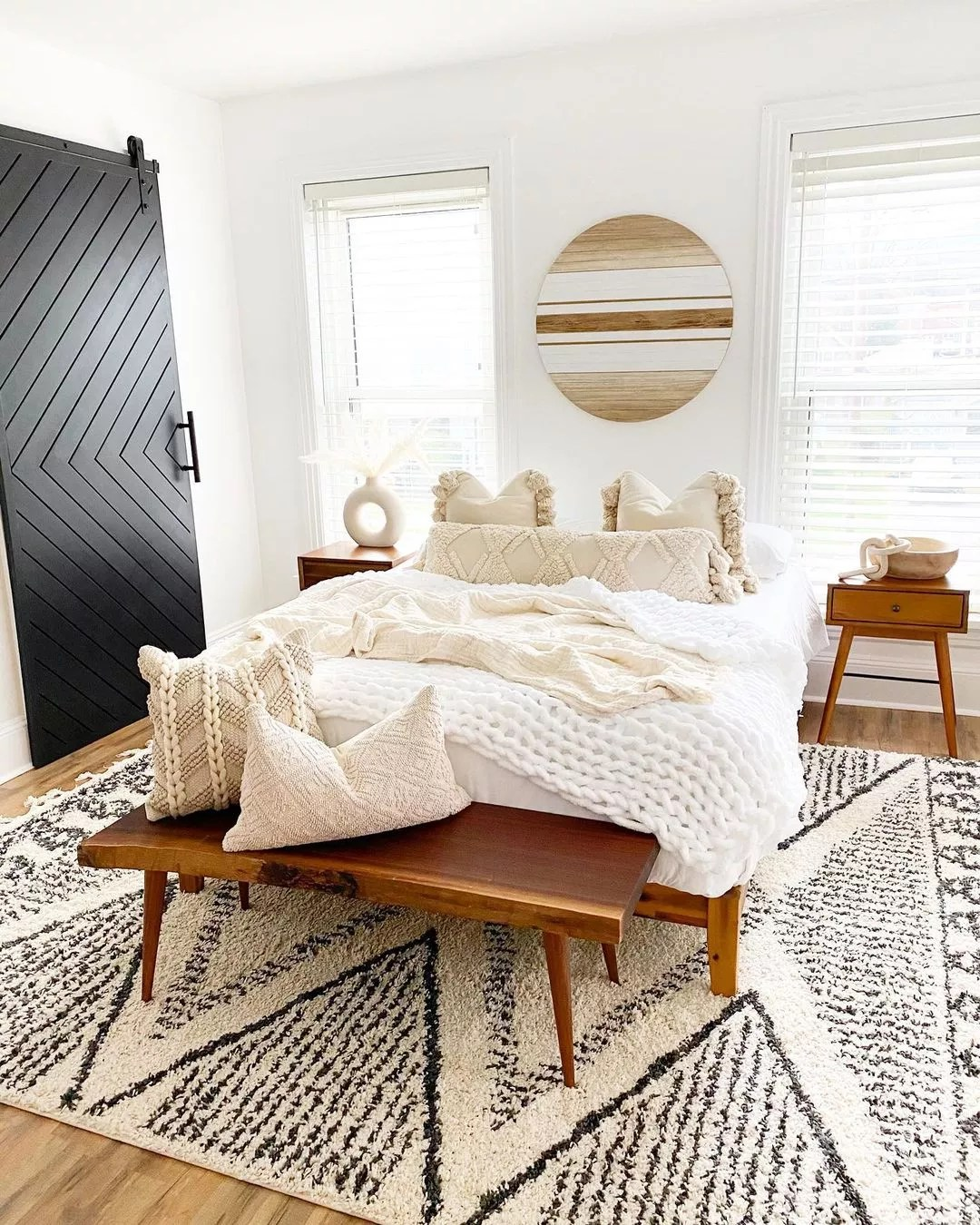 Bright boho bedroom with black and white patterned rug. Photo by Instagram User @modernly_you