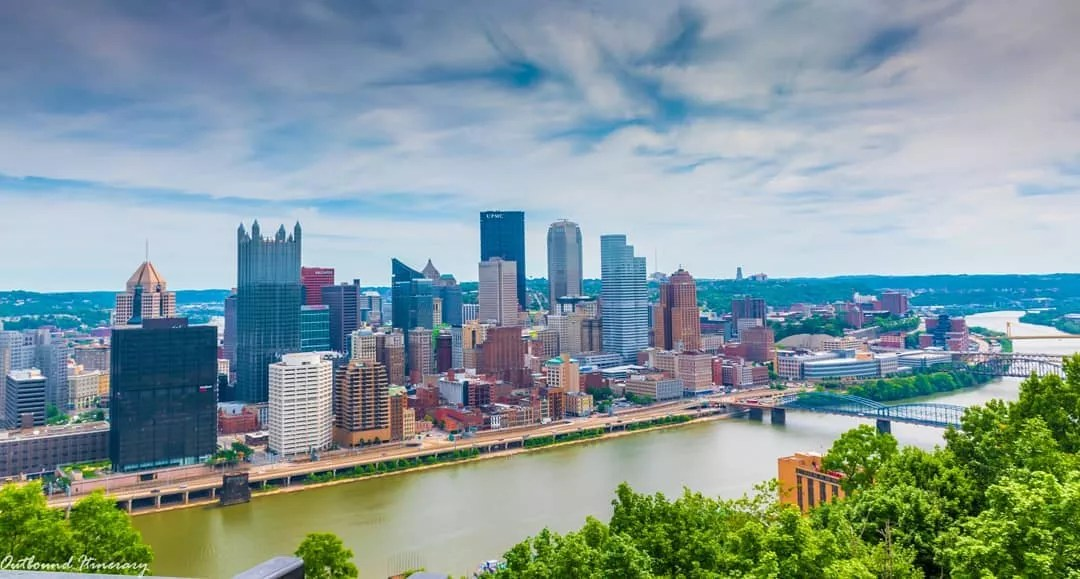 Skyline photo of Pittsburgh on overcast day. Photo by Instagram User @outbounditinerary
