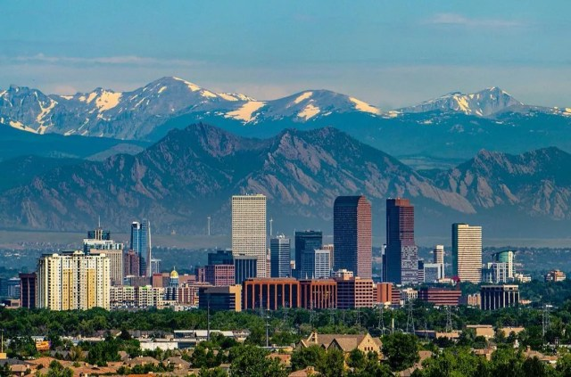 Shot of downtown Denver, CO with Rocky Mountains in the background. Photo by Instagram user @sam_kilman