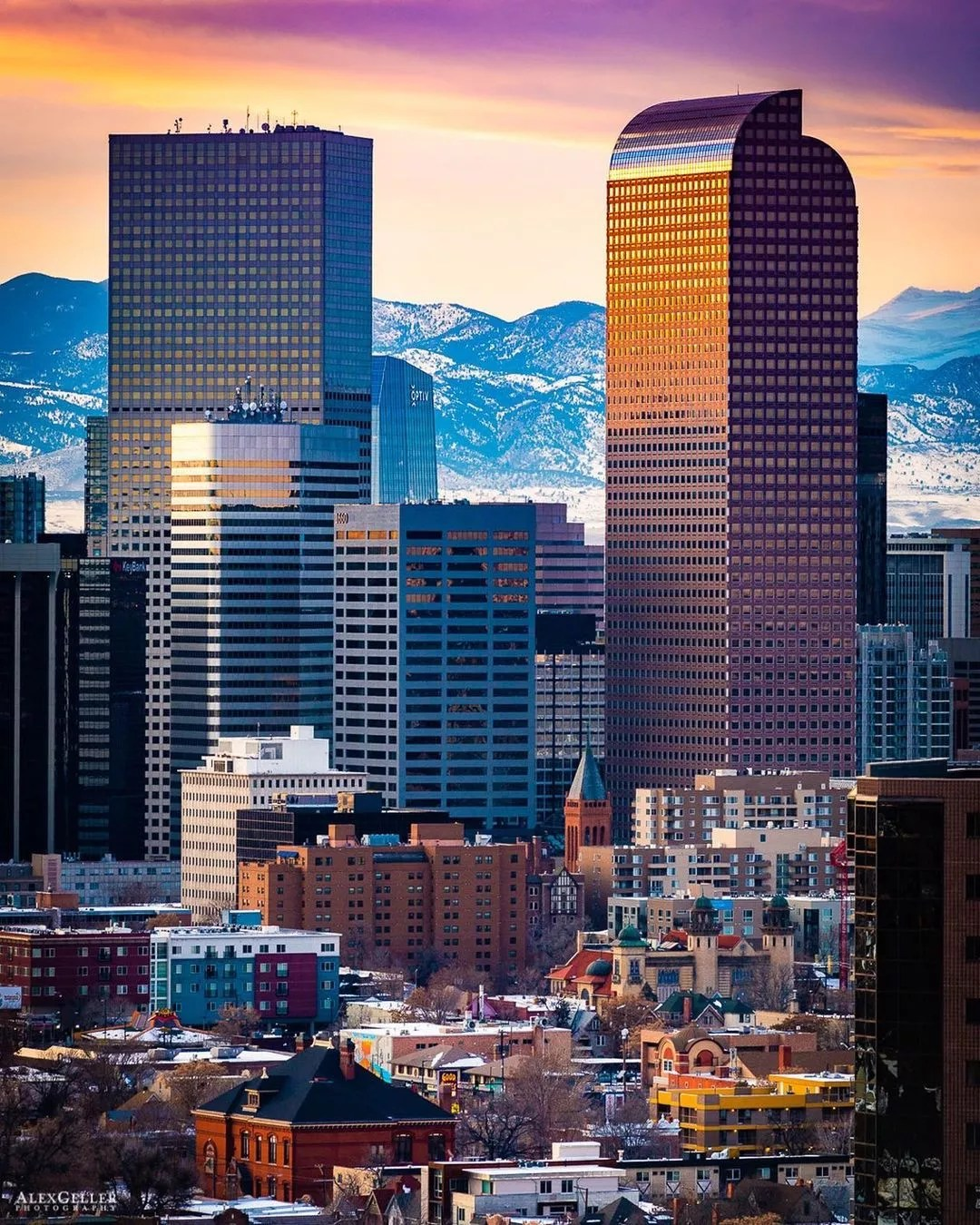 View of Downtown Denver, CO Skyline with Rocky Mountains in the Background. Photo by Instagram user @agellerphoto