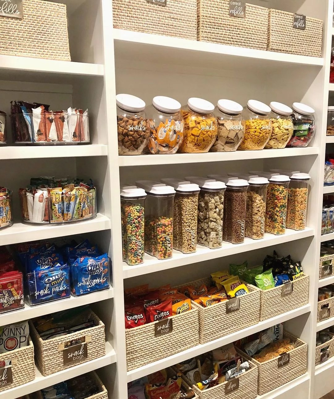 Pantry organized with storage containers and glass canisters. Photo by Instagram user @azhouseoforder