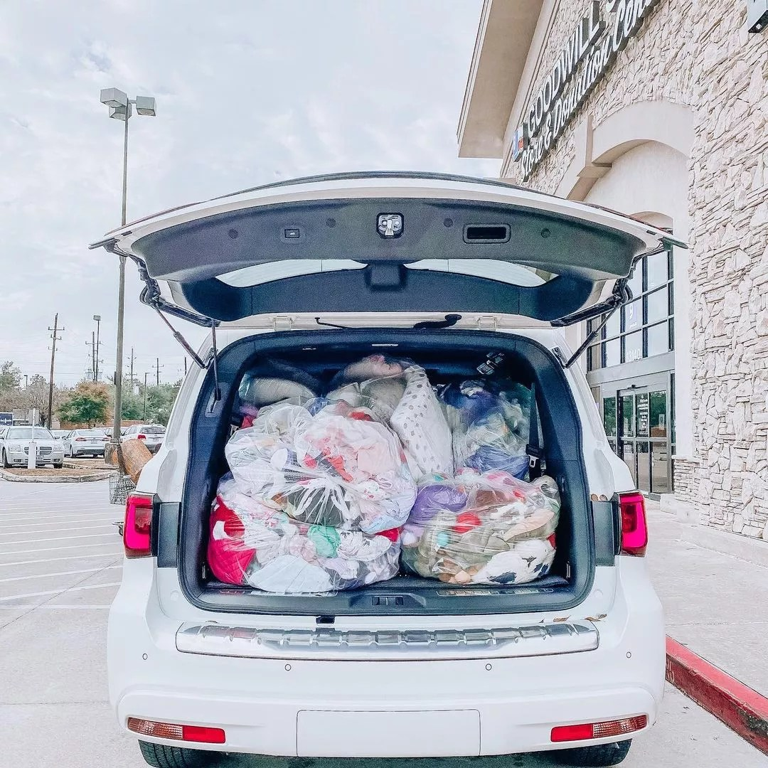 Car trunk full of donation bags. Photo by Instagram User @organizedlifedesign