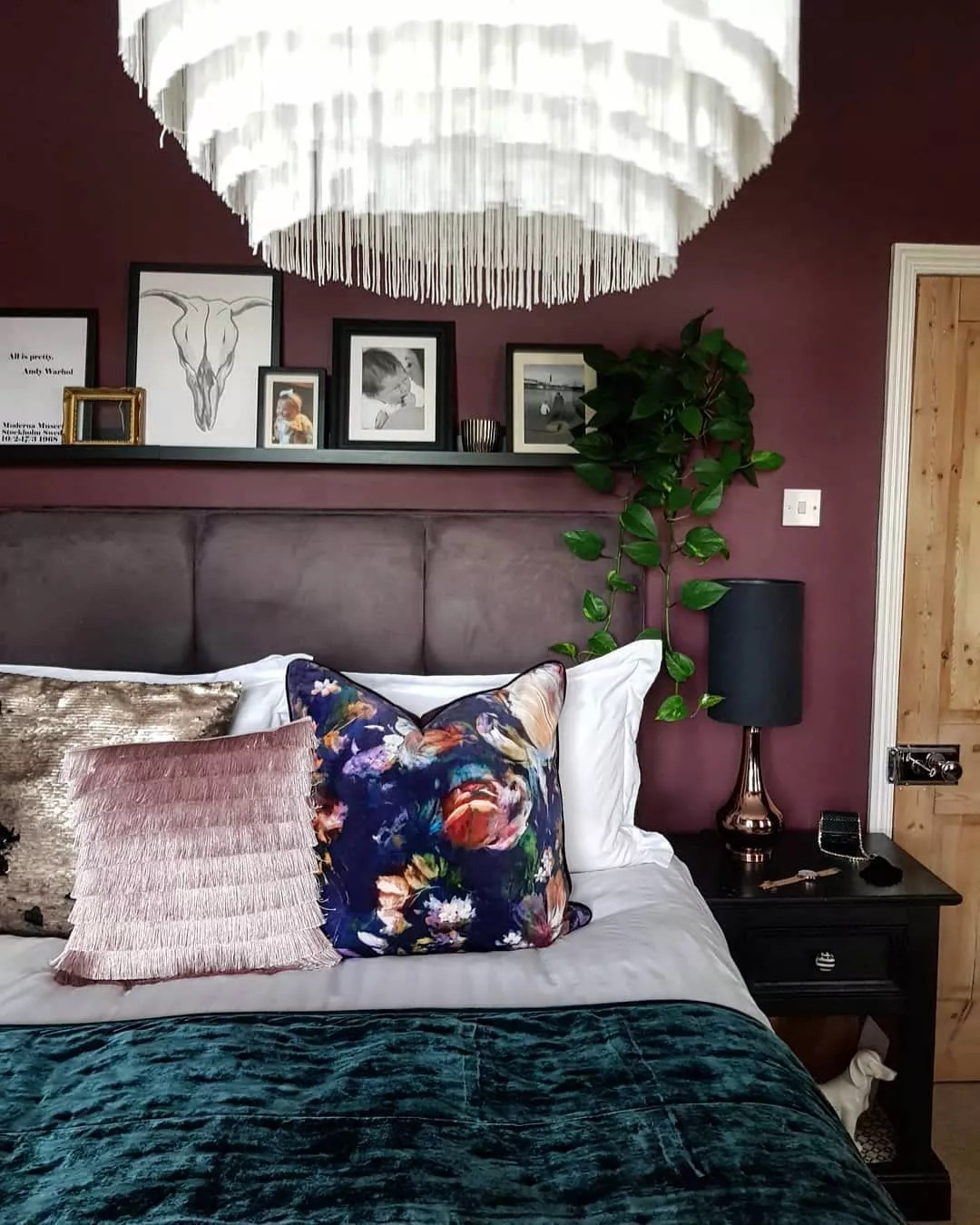 Small bedroom painted a wine red. Photo by Instagram user @bramblelaneinteriors.