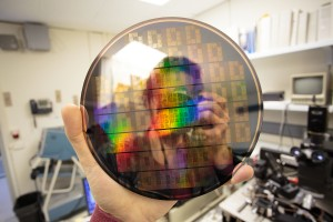 Sebastian Anthony holding a wafer of graphene chips at IBM Research