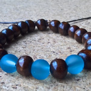 Handmade bracelet with blue glass and brown wood beads