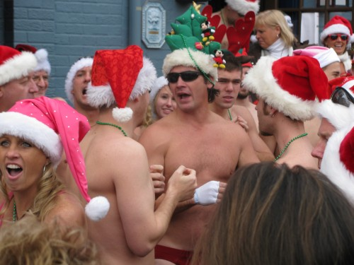 Speedo clad Santas party outside Federal House in Annapolis