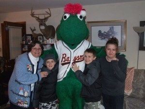 Louie, the Bowie Baysox Mascot poses with family