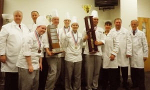 Team Anne Arundel from the Hotel, Culinary Arts and Tourism Institute at Anne Arundel Community College poses with their medals and trophies after placing first in the Chesapeake Culinary Cup competition.