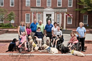 Front Row Left to Right People Emma Banner, Nancy Patterson, Sean McDonough, Jessica Yeager Back Row Left to Right People Cara Banner, MacKenzie Andrews, Senator Ed Reilly, Senator John Astle, Mike Hartsky,Karen McDonough, Susan Sommers Dogs left to right- Assistance Dogs in Training and Service Dogs: Bud,  Spike, Newcomb, Belmont, Mahler, Jefferson, Madge Photo by :   Linda McCarthy         Posh Pet Portraits, a division of Visual Concepts Photography