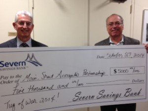 Alan Hyatt (l) of Severn Savings Bank presents a check to Steve Samaras (r), President of MainStreets Annapolis and owner of Zachary's Jewelers.