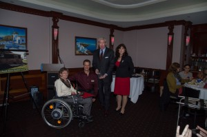 Disability Awareness Day Co-Chairperson Ginger Palmer accepts a Legacy Award on behalf of the Commission.  From left to right: Ginger Palmer, Disability Awareness Day Co-Chairperson; Bruce Morgenstern, Board President of the Anne Arundel County Volunteer Center; Sean Looney, Vice President of Comcast Government Affairs; Pam Jordan, Director of the Anne Arundel County Department of Aging and Disabilities.