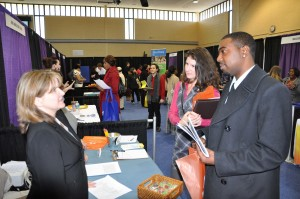 Jobseekers speak with a business representative at the Spring 2014 AACC Job Fair. This year's event is April 16, from noon to 4 p.m. at the David S. Jenkins Gymnasium on AACC's Arnold campus, 101 College Parkway.