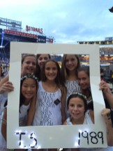 A group of tweens from Glenwood, MD pose with their 1989 album cover inspired Polaroid frame in matching outfits.