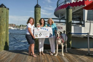 Watermark presents a check for $1,462.50 to the Anne Arundel County SPCA from the 3rd Annual Dog Days of Summer Cruise. (l to r) Director of Sales and Marketing at Watermark April O'Brien, AACSPCA President Kelly Brown, and Group Sales Account Manager at Watermark Jennifer DeLancey. Photo by Sabrina Raymond.