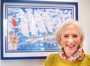 Nancy Hammond poses with her Chesapeake-themed 2011 poster release. (PHOTO BY M. J. NEUBERGER)