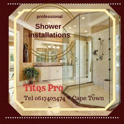 Glass shower installed in large cream bathroom as example of work done by Titos Pro in Cape Town