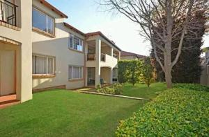 Duplexes with green lawn renovated by Nickluk Projects in Cape Town
