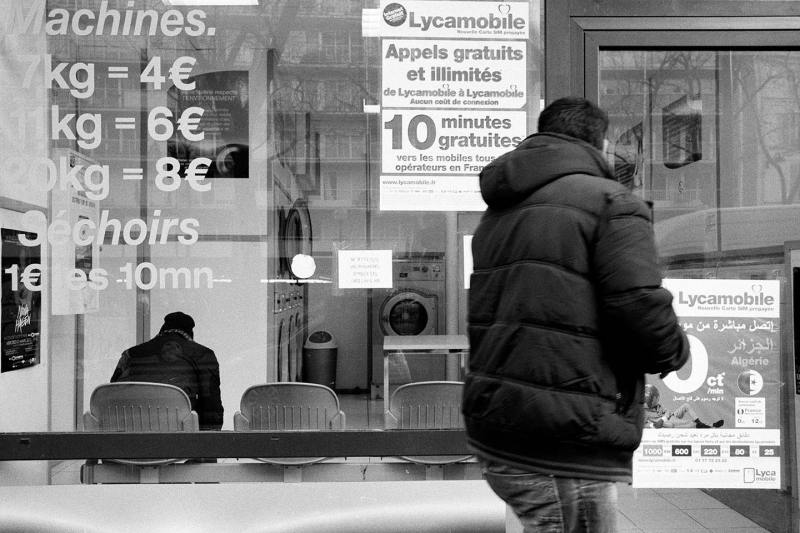 Paris, a man on his smart phone waiting for the subway
