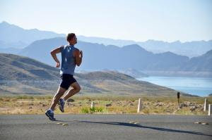 jogger running for men's health down a street