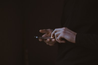 caucasian hands holding a cell phone