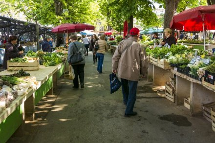 farmer's market with people walking around.