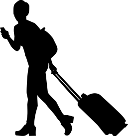 silhouette of a person with a traveling suitcase rolling behind them