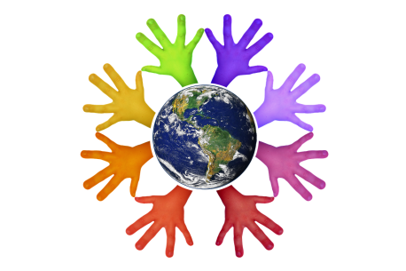 planet earth with different colored hands coming out from all around it