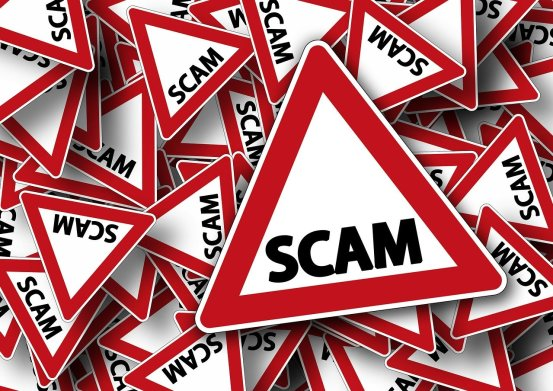 scam warning signs piled on top of each other