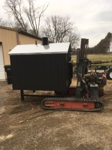 Custom built outdoor furnace moving machine.
