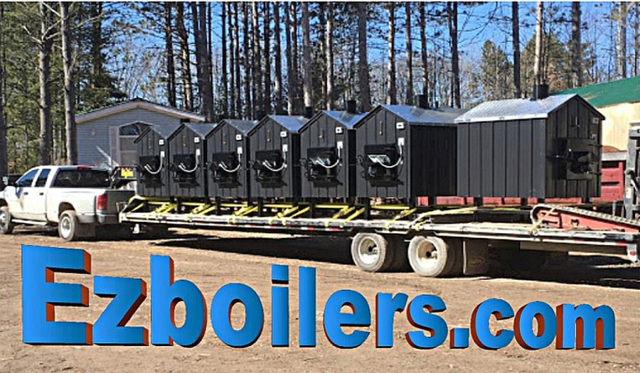 Ezboilers outdoor wood stoves loaded on trailer for delivery.