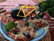 Fixie bike pizza cutter in use
