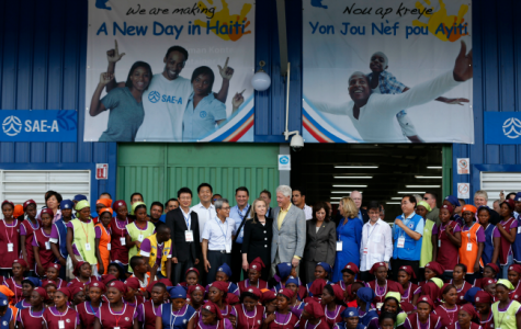 Caracol- Obama's Sweatshops as development for Haiti. Haiti industrial park opening Caracol Former U.S. President Bill Clinton and U.S. Secretary of State Hillary Clinton pose with workers at the grand opening ceremony of the new Caracol Industrial Park in Caracol, Haiti, on October 22, 2012. (Larry Downing/Reuters)