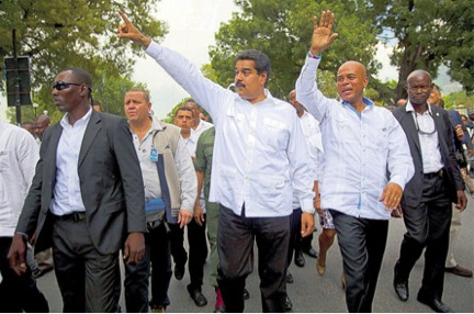 Super-leftist Venezuelan leader Nicolas Maduro cozy up to despotic Right-wing US puppet- president, Michel Martelly