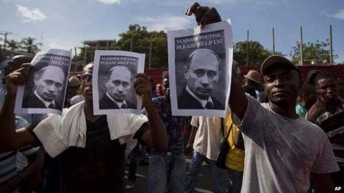 "Haiti Protestors holding signs that read ""Vladimir Putin, Please Help Us!"""