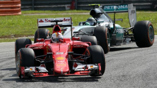 Vettel overtakes Nico Rosberg during the Malaysian GP
