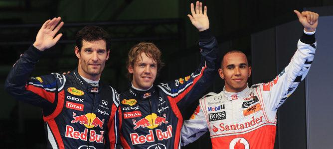 A la izquierda Webber, al centro Vettel y a la derecha Hamilton