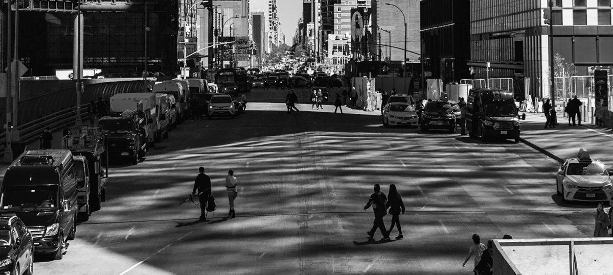 Pedestrians walking across street in New York City