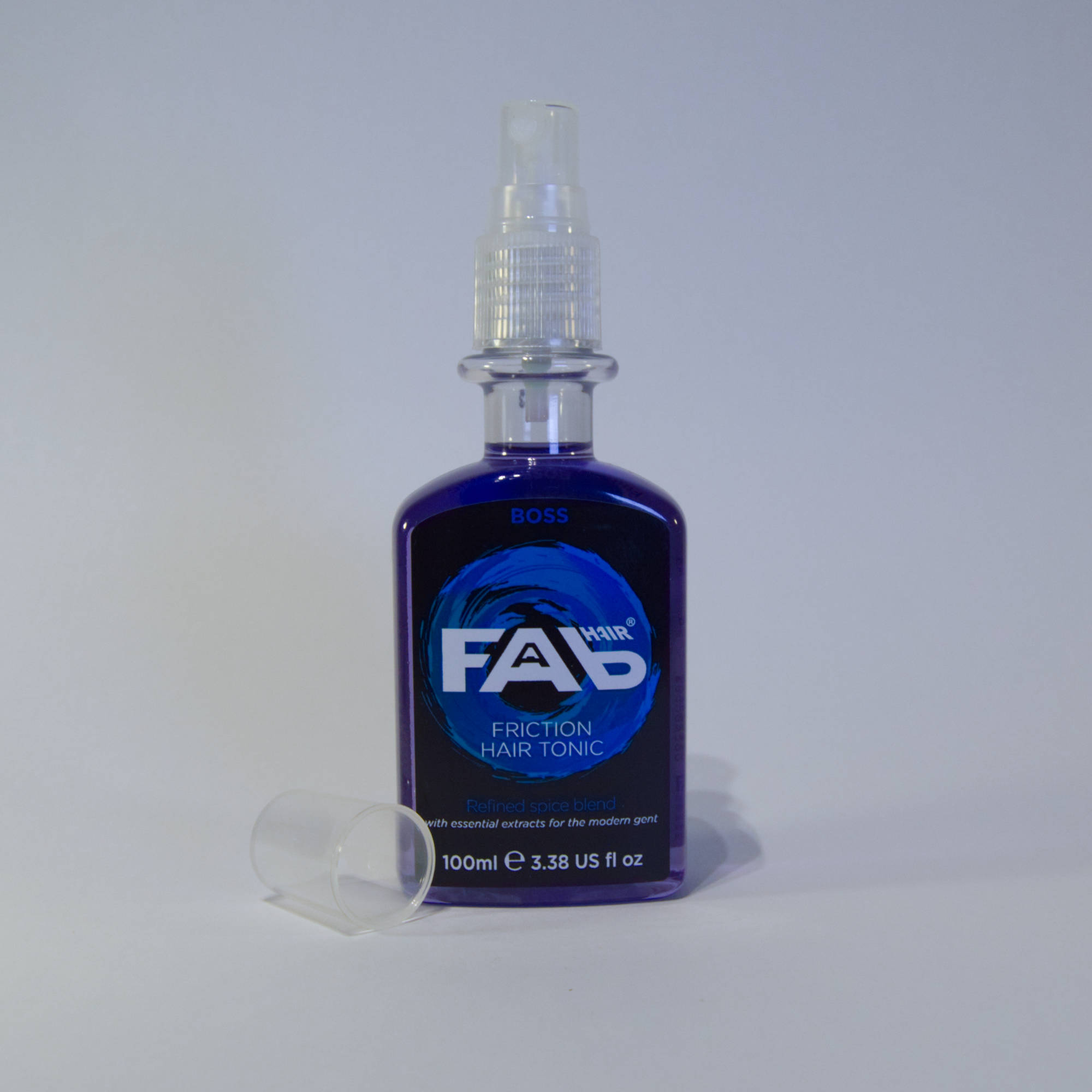 100ml bottle of Boss flavoured FAB friction hair tonic with Spray Nozzle