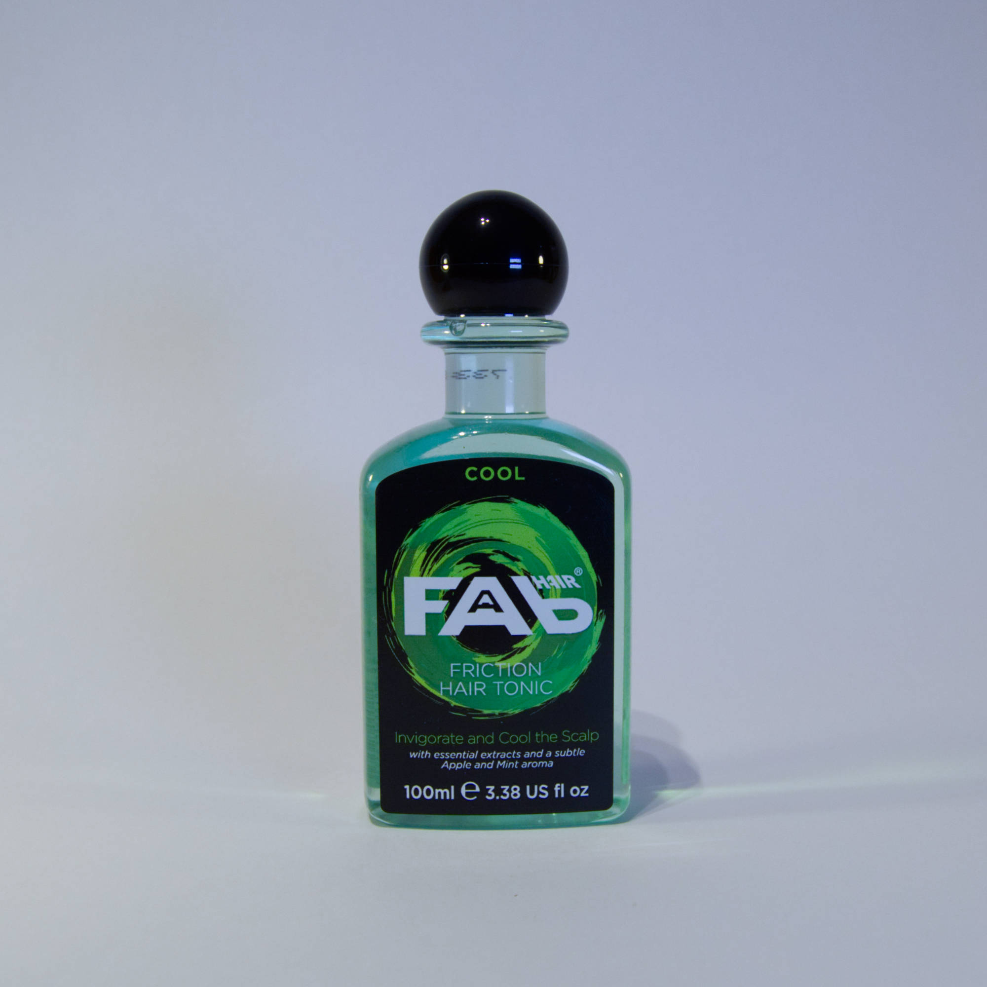 100ml bottle of Cool flavoured FAB friction hair tonic