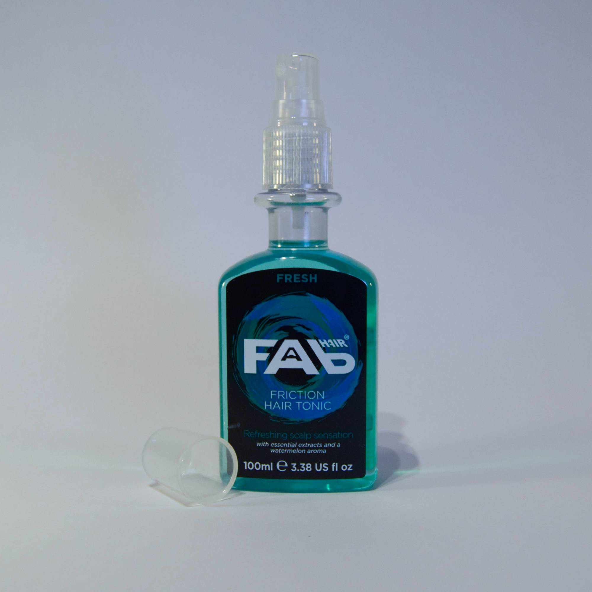 100ml bottle of Fresh flavoured FAB friction hair tonic with Spray Nozzle