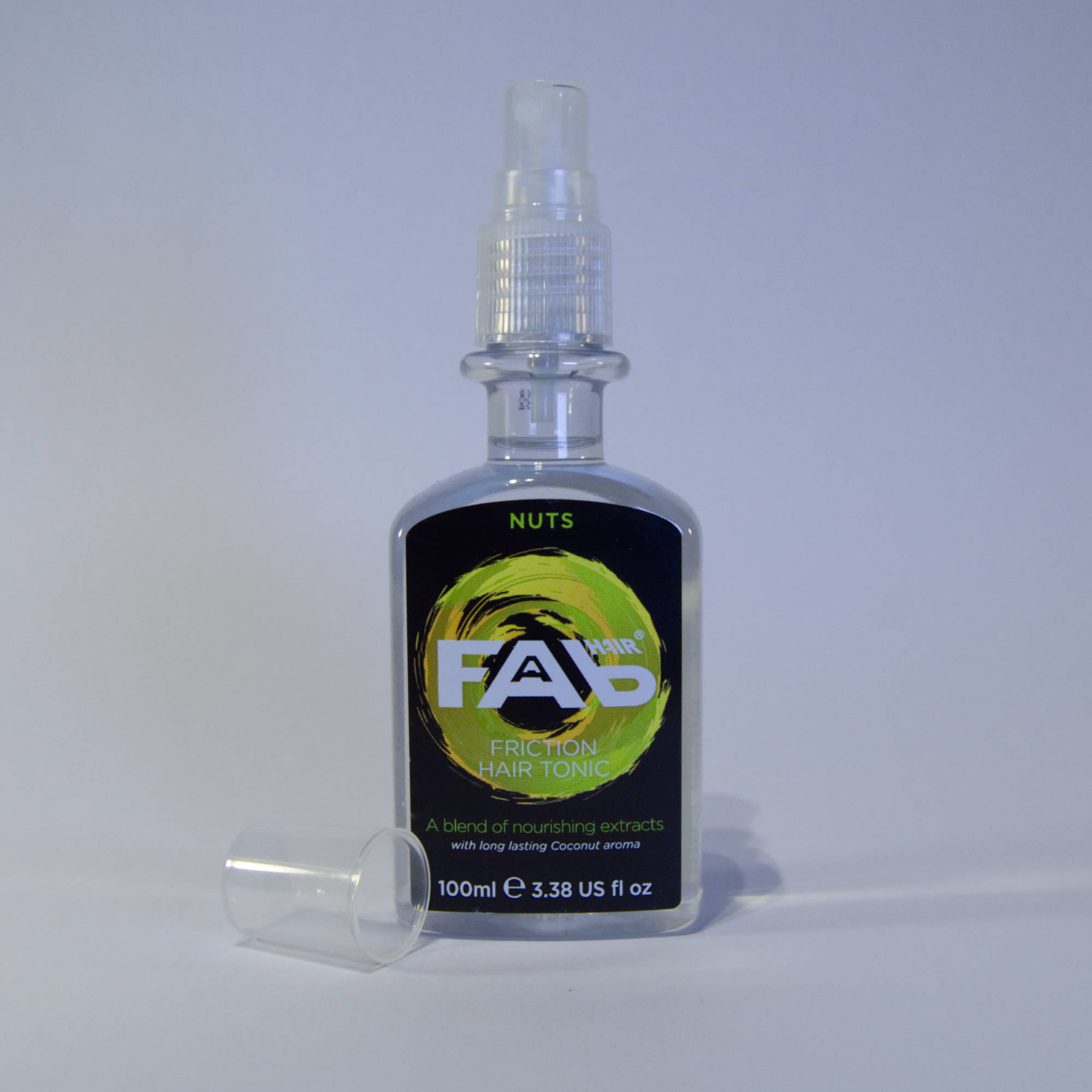 100ml bottle of Nuts flavoured FAB friction hair tonic with Spray Nozzle