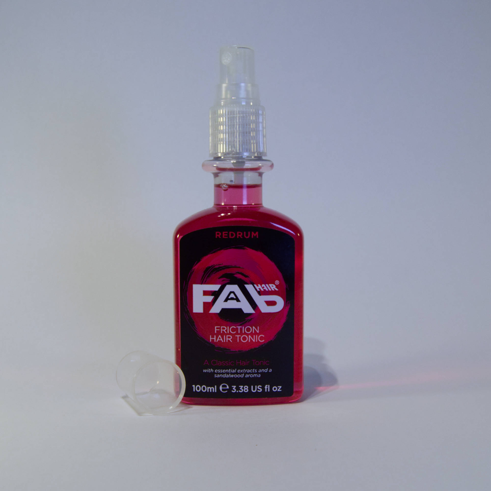 100ml bottle of Redrum flavoured FAB friction hair tonic with Spray Nozzle