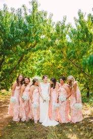 Unique bridesmaid style ideas to make your bridal party stand out on your big day - printed bridesmaid dresses | Photography : marymargaretsmith.com | https://www.fabmood.com/a-cozy-fall-wedding-in-the-peach-orchard #peach #fallwedding