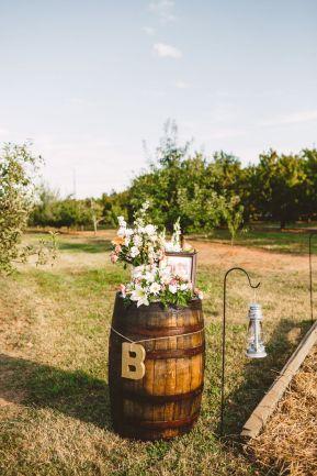 Wine-barrel - Rustic Wedding in The Peach Orchard | Photography : marymargaretsmith.com | https://www.fabmood.com/a-cozy-fall-wedding-in-the-peach-orchard #peach #fallwedding