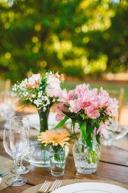 simple wedding centerpieces - wedding reception in The Peach Orchard | Photography : marymargaretsmith.com | https://www.fabmood.com/a-cozy-fall-wedding-in-the-peach-orchard #peach #fallwedding