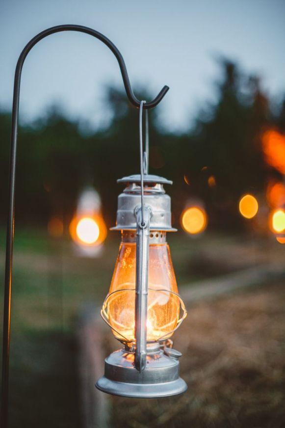 Lantern hung on sherpard hook - wedding decor in The Peach Orchard | Photography : marymargaretsmith.com | https://www.fabmood.com/a-cozy-fall-wedding-in-the-peach-orchard #peach #fallwedding